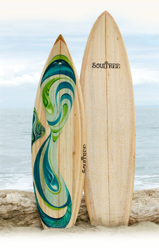 2 balsa wood surfboards on the beach
