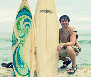 Jesee with Balsa Wood Surfboard