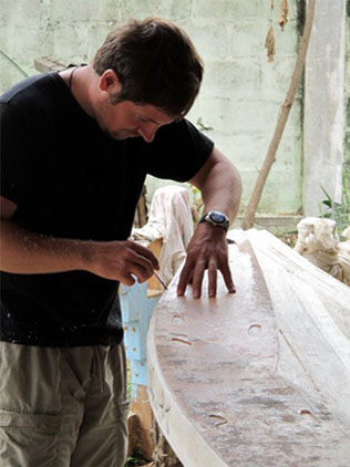 Jesse Raymond shaping a Soultree board